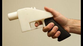 3D printed gun being held.