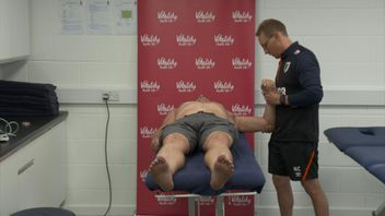 Lewis Pugh receives treatment on his shoulder from medical staff at AFC Bournemouth.