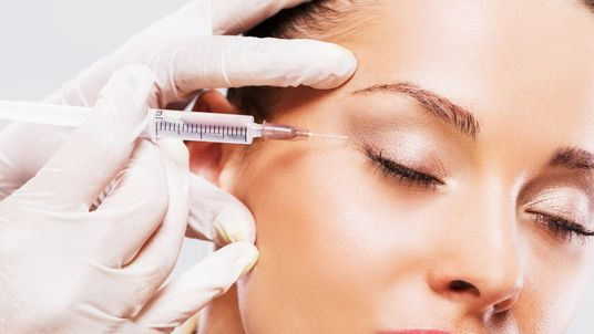 Close up of woman receiving beauty treatment with Botox.