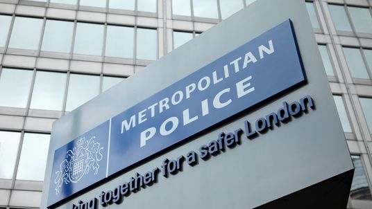 ndon, England - May 8, 2011: The famous New Scotland Yard sign, outside the Metropolitan police headquarters in London.
