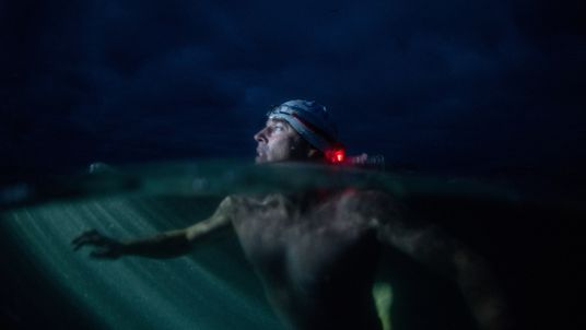 Renowned endurance swimmer and United Nation...s Environment Programme (UNEP)...s Patron of the Oceans, Lewis Pugh swims past Start Point, United Kingdom during The Long Swim campaign on 27 July 2018