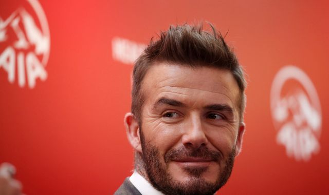 David Beckham could face court after 'using mobile while driving'