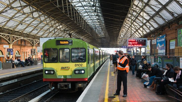 'Dublin, Ireland - November 12, 2008: Passengers and personel looking at DART (Dublin Area Rapid Transit) train at Pearse Station.'