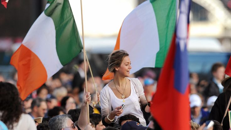 A young pilgrim from Ireland celebrates as she sees Pope Benedict XVI arrive at the World Youth Day (WYD) festivities, in Sydney on July 17, 2008. The world's biggest Christian festival opened on July 15 with thousands of pilgrims making the journey to take part in World Youth Day celebrations headed by Pope Benedict XVI. AFP PHOTO/William WEST (Photo credit should read WILLIAM WEST/AFP/Getty Images)