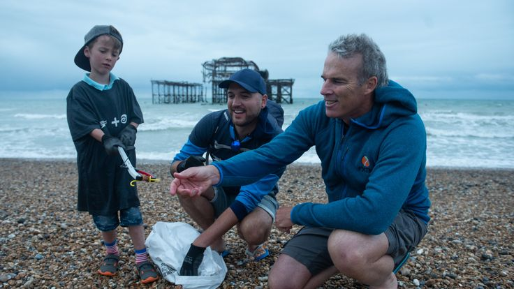 Lewis helps to collect plastic from the beach on day 38