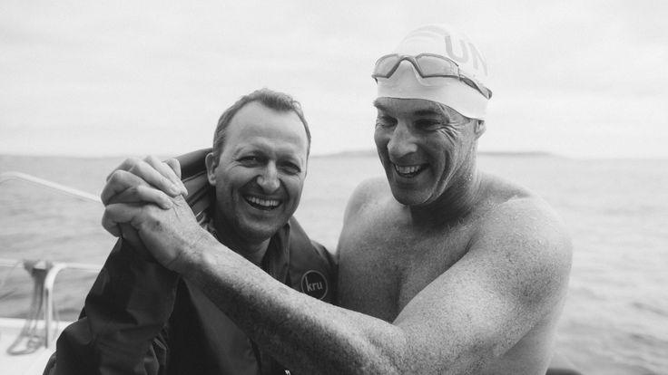 Lewis and friend David Becker celebrate the fast swim