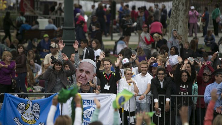 PHILADELPHIA, PA - SEPTEMBER 27: People wait for Pope Francis pass on his way to celebrate mass along Benjamin Franklin Parkway on September 27, 2015 in Philadelphia, Pennsylvania. Pope Francis wrapped up his United States tour with the World Meeting of Families Papal Mass during on the Benjamin Franklin Parkway. (Photo by Jessica Kourkounis/Getty Images)