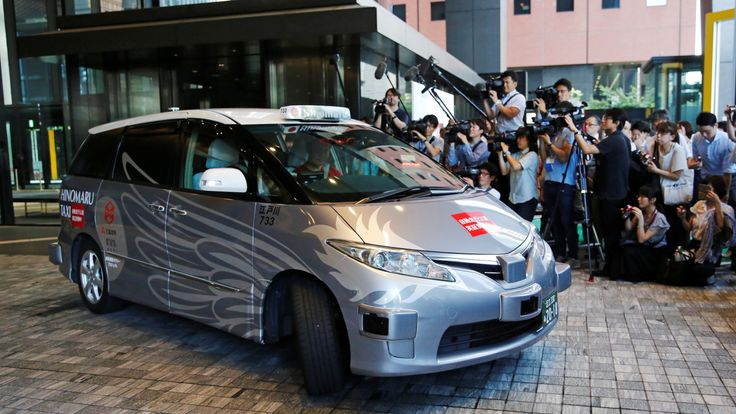 ZMP Inc's RoboCar MiniVan, a self-driving taxi based on a Toyota Estima Hybrid car, operated by Hinomaru Kotsu Co, is seen at the start of its services proving test in Tokyo, Japan August 27, 2018. REUTERS/Toru Hanai