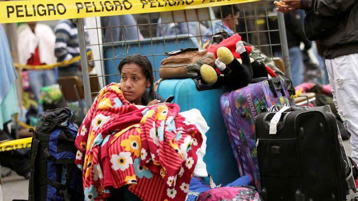 A Venezuelan migrant waits in line to register their entry into Ecuador, at the Rumichaca International Bridge