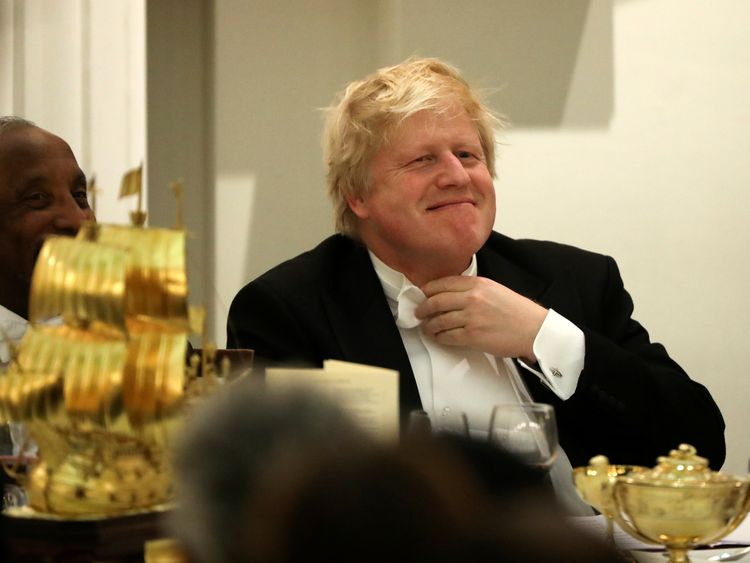 Boris Johnson reacts before speaking at a banquet with diplomats at Mansion House in London