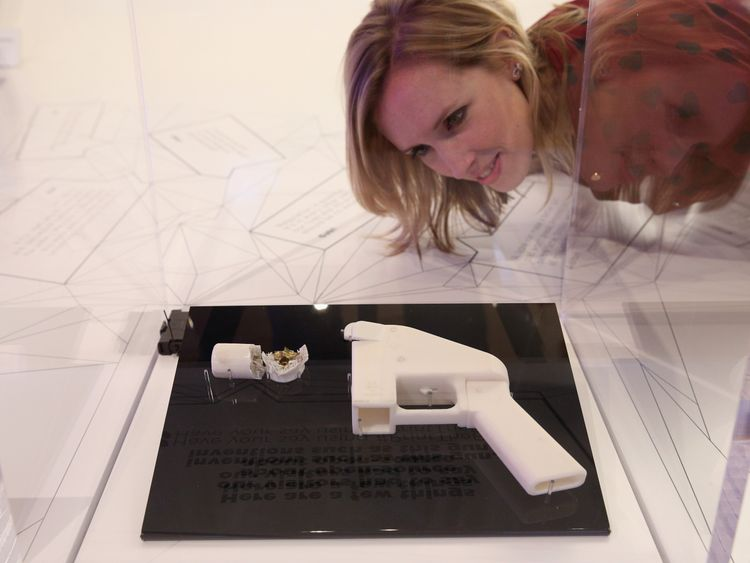 A 3D printed gun that has been fired is displayed at the Science Museum