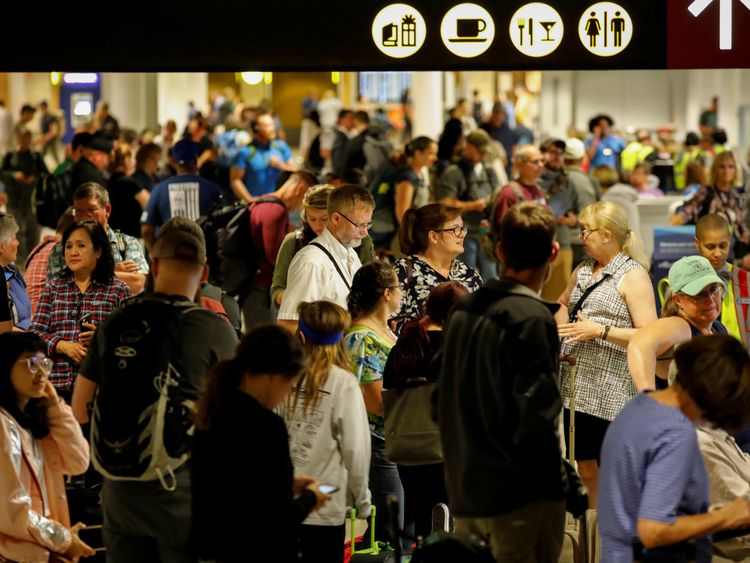 Air Alaska passengers wait in the terminal following an incident where an airline employee took off in an airplane, at Seattle-Tacoma International Airport in Seattle, Washington, U.S., August 10, 2018