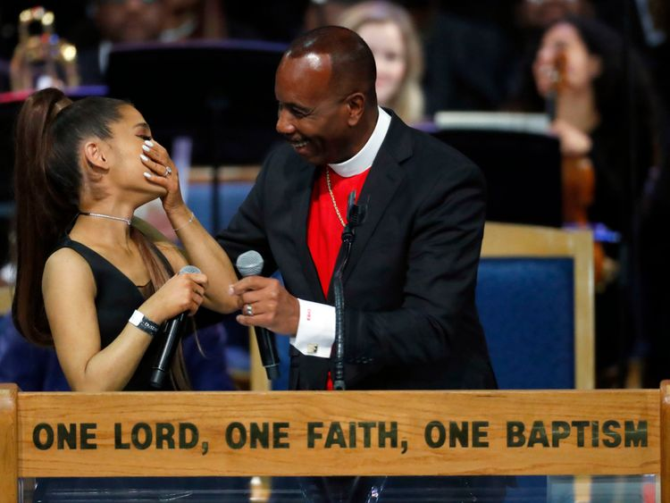 Ariana and Bishop Ellis share a laugh after her performance