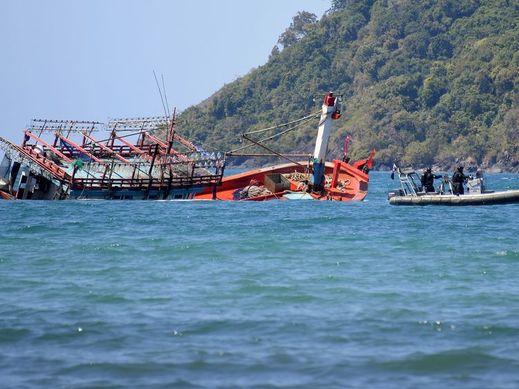 Police inspect a sunken vessel at Cape Kimberley, located near the the Daintree River in northern Queensland, Australia