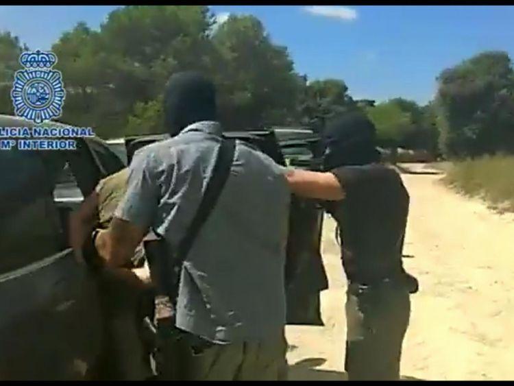 Armed Spanish police arrest Brech after a tip-off