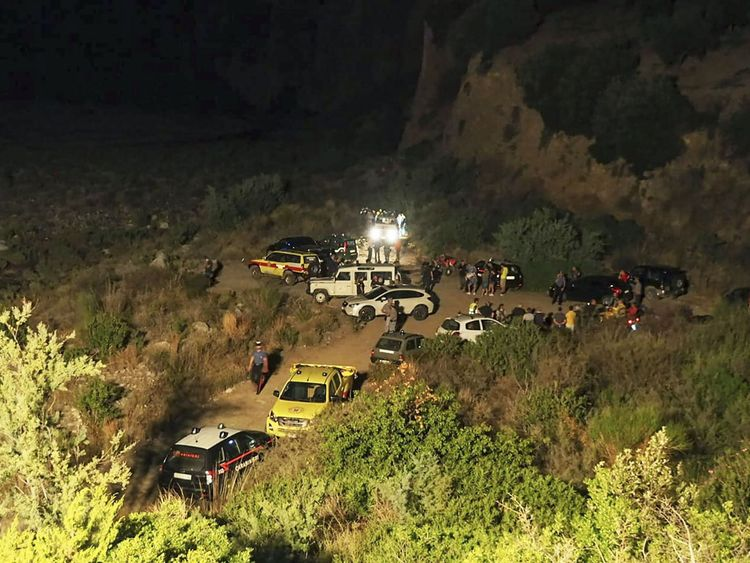 Rescue teams get ready to search for survivors after flooding in the Raganello Gorge, Calabria.