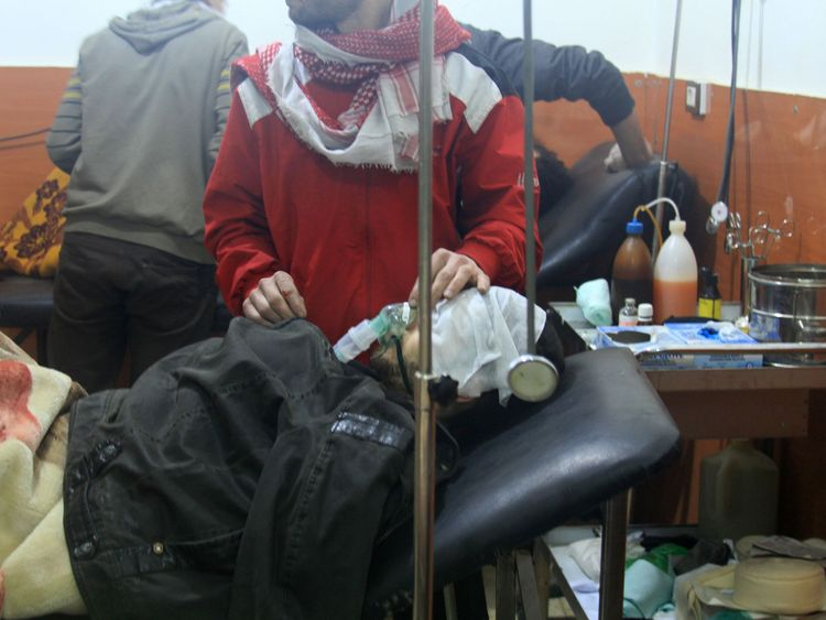 People receive treatment at a field hospital after an alleged poison gas attack by Regime troops in 2014