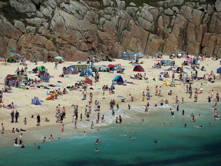 Holidaymakers enjoy the beach at Porthcurno, near Penzance