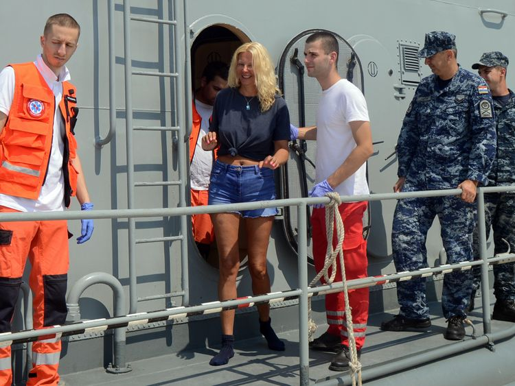 Kay Longstaff leaves a rescue ship after being saved from the water