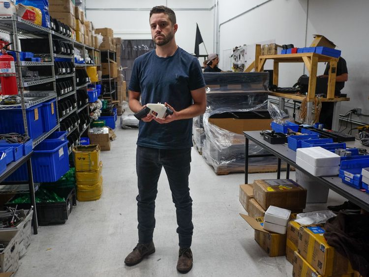 Cody Wilson, owner of Defense Distributed company, holds a 3D printed gun, called the 'Liberator', in his factory in Austin, Texas on August 1, 2018. - The US 'crypto-anarchist' who caused panic this week by publishing online blueprints for 3D-printed firearms said Wednesday that whatever the outcome of a legal battle, he has already succeeded in his political goal of spreading the designs far and wide