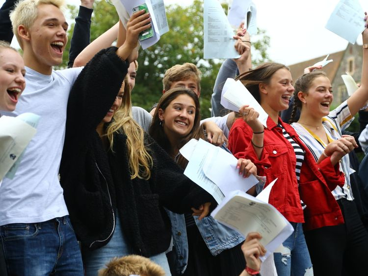 Students celebrate as they collect their GCSE results at Brighton College