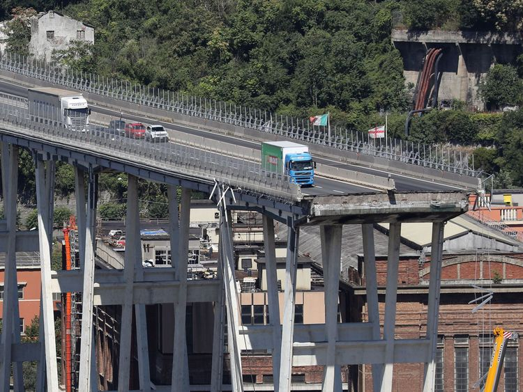 Vehicles have been abandoned on the precipice of the remains of the bridge