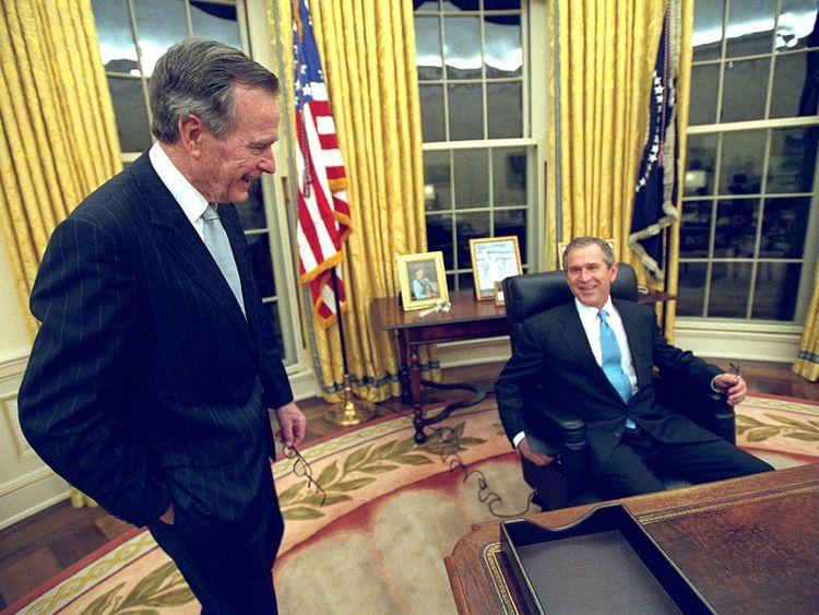 George HW Bush (L) and his son George W Bush in 2001