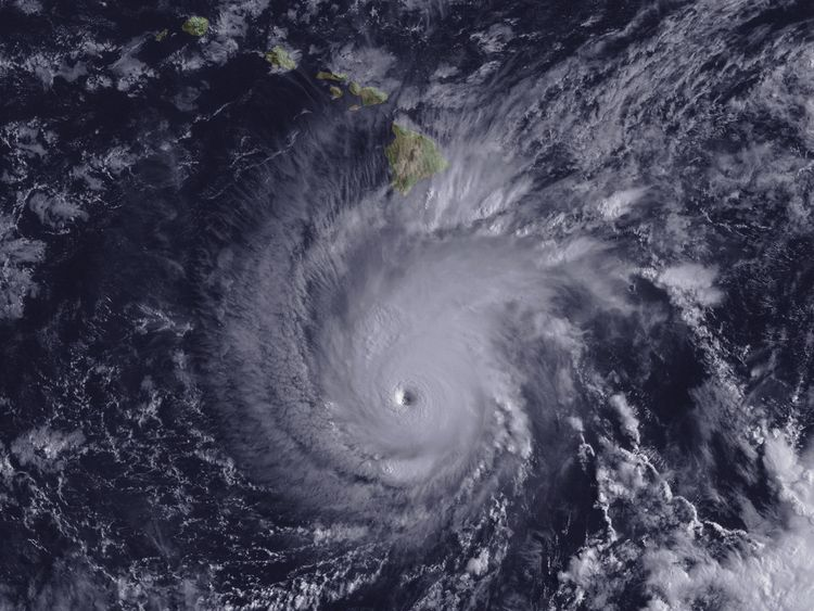 Hurricane Lane, with a well-defined eye, is shown positioned about 300 miles south of Hawaii's Big Island at 2 p.m. ET on August 22, 2018. NOAA/Goes-East Imagery/Handout via REUTERS THIS IMAGE HAS BEEN SUPPLIED BY A THIRD PARTY. IT IS DISTRIBUTED, EXACTLY AS RECEIVED BY REUTERS, AS A SERVICE TO CLIENTS