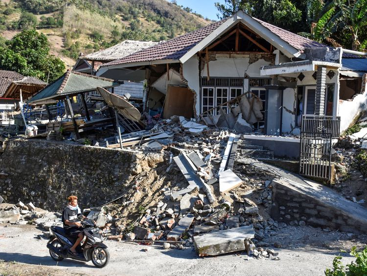 A damaged home following a strong earthquake in Pemenang, North Lombok, Indonesia