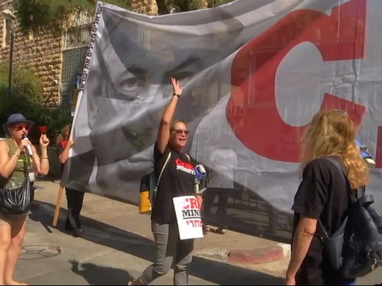 Mr netanyahu's face was at either end of the banner with the words 'crime minister'