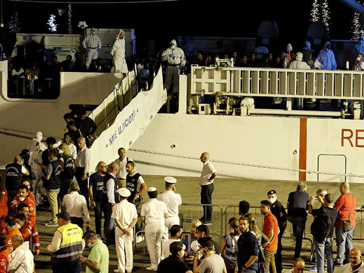 Police photographed the migrants for ID checks when they disembarked the ship