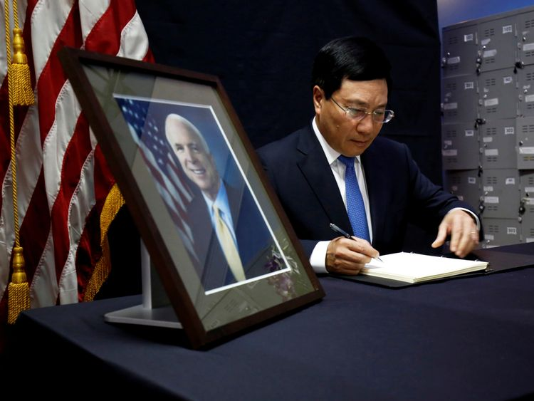Vietnam's Foreign Minister Pham Binh Minh writes in a condolence book