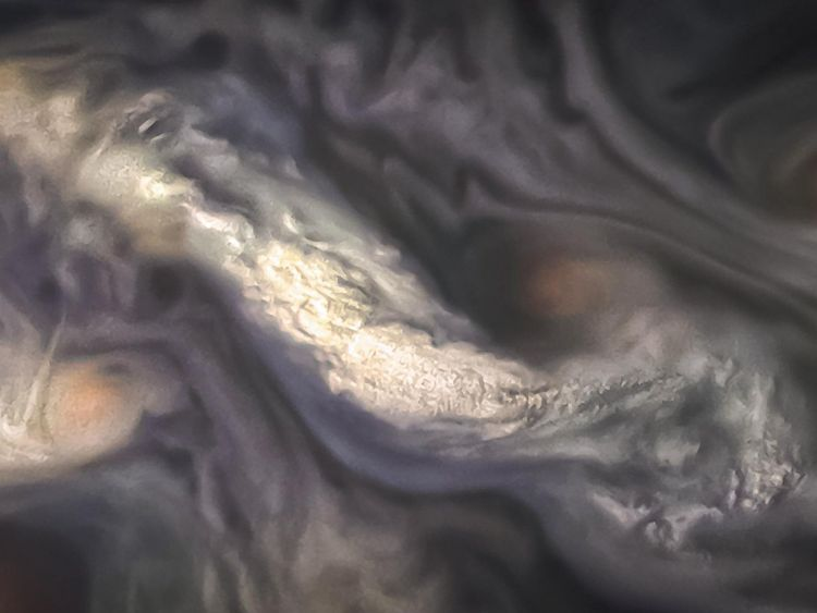 Mystery of Jupiter's colourful bands 'solved'