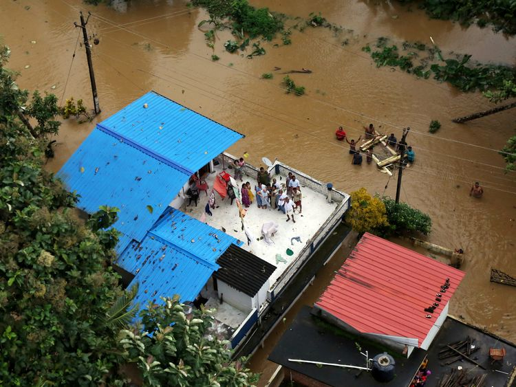 Many people have been seen of the roofs of buildings awaiting rescue