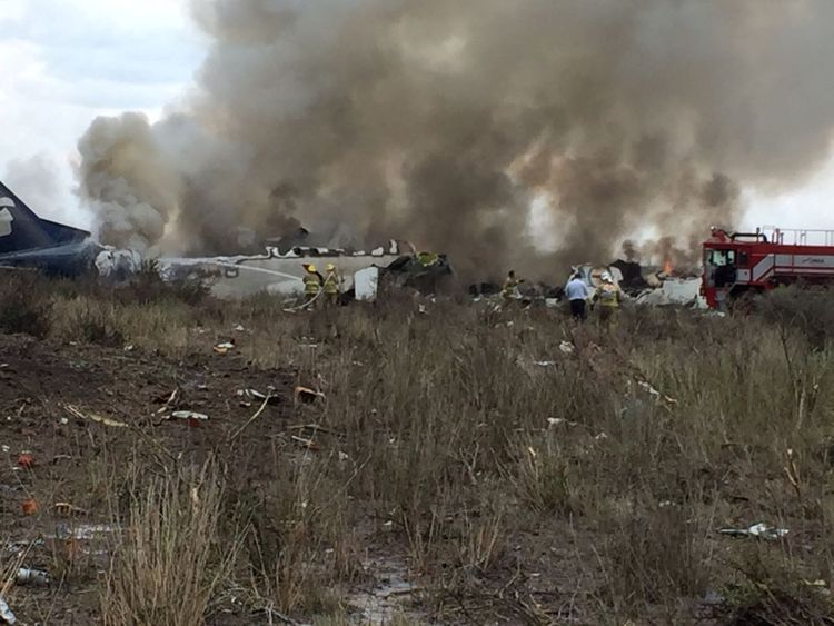 Rescue personnel work at the site where an Aeromexico-operated Embraer passenger jet crashed in Mexico's northern state of Durango