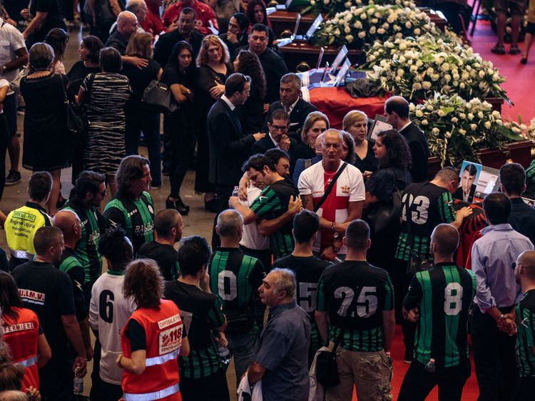 Jeers for ex-officials at Genoa bridge state funeral