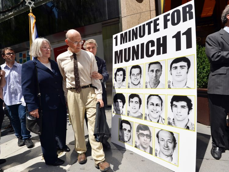 Avi Melamed (2nd L), surviving member of the 1972 Israeli Olympic team, walks past a poster after he joined Jewish and New York community members in a moment of silence July 27, 2012 in New York to honor the 11 Israeli Olympic athletes killed by Palestinian militants at the 1972 Munich games. AFP PHOTO/Stan HONDA (Photo credit should read STAN HONDA/AFP/GettyImages)