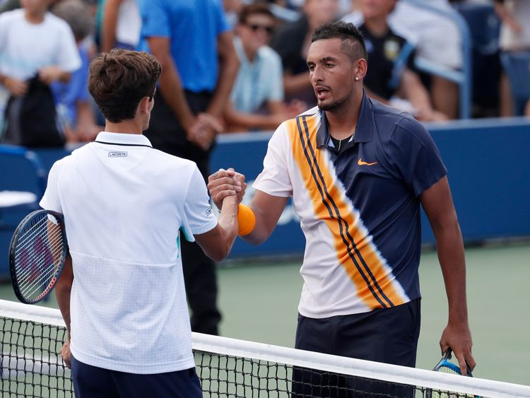 Aug 30, 2018; New York, NY, USA; Nick Kyrgios of Austria (right) greets Pierre-Hugues Herbert of France (left) after a second round match on day four of the 2018 U.S. Open tennis tournament at USTA Billie Jean King National Tennis Center. Mandatory Credit: Jerry Lai-USA TODAY Sports