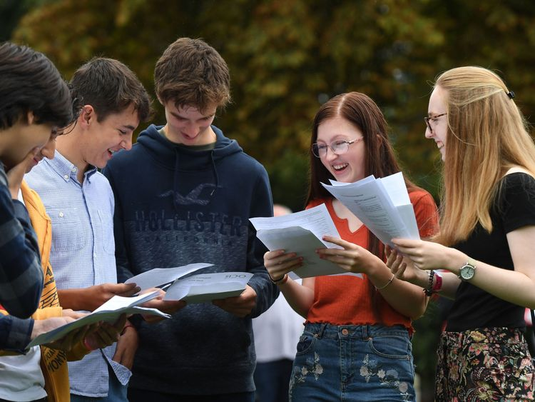 Angus Toms, James Thistlewood, Amy Buck and Katja Ruda celebrate after collecting their GCSE results at Norwich School