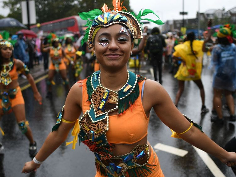 Dancers perform during the Children's Day parade at the Notting Hill Carnival in west London