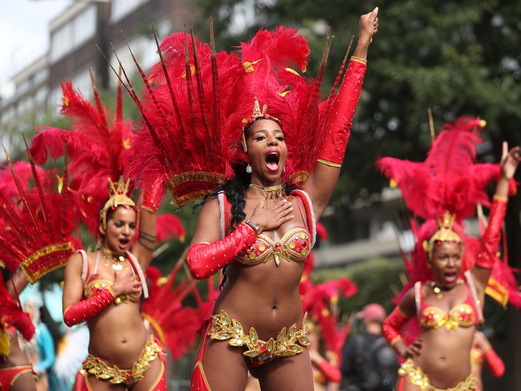 Performers in costume take part in the carnival on the main Parade day of the Notting Hill Carnival in west London on August 27, 2018. - Nearly one million people are expected by the organizers Sunday and Monday in the streets of west London's Notting Hill to celebrate Caribbean culture at a carnival considered the largest street demonstration in Europe. (Photo by Daniel LEAL-OLIVAS / AFP) (Photo credit should read DANIEL LEAL-OLIVAS/AFP/Getty Images)