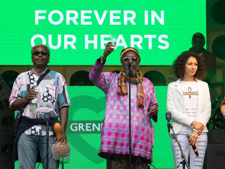 EDITORIAL USE ONLY Eric Carboo aka Lord Eric Sugumugu (centre) with Empress Emmanuelle (left) lead tributes to the victims of the fire in the Grenfell Tower from stage at Casa BACARDê at Powis Square Stage, Notting Hill Carnival, London.