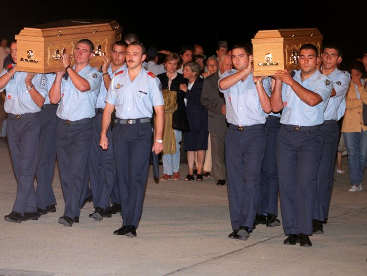 Spanish Air Force soldiers carry the coffins of two Spanish Omagh victims