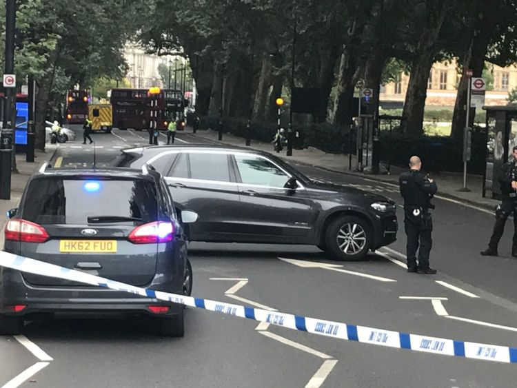 Police vehicles in Westminster after a vehicle crashes into the Houses of Parliament