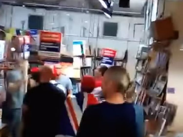 """Still from a video (https://www.youtube.com/watch?v=9ZIfDSkCiv0) of a """"Make Britian Great Again"""" protest inside a socialist bookshop"""