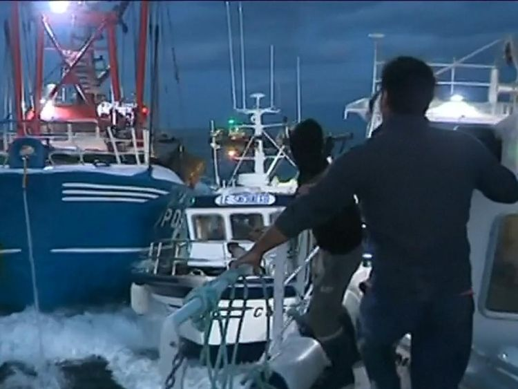 Scallop fishermen ram their boats into each other in a dispute over rights to fish
