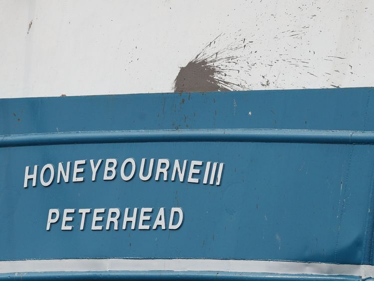 A splatter mark on the stern of the Honeybourne 3, a Scottish scallop dredger, in dock at Shoreham, West Sussex, following clashes with French fishermen