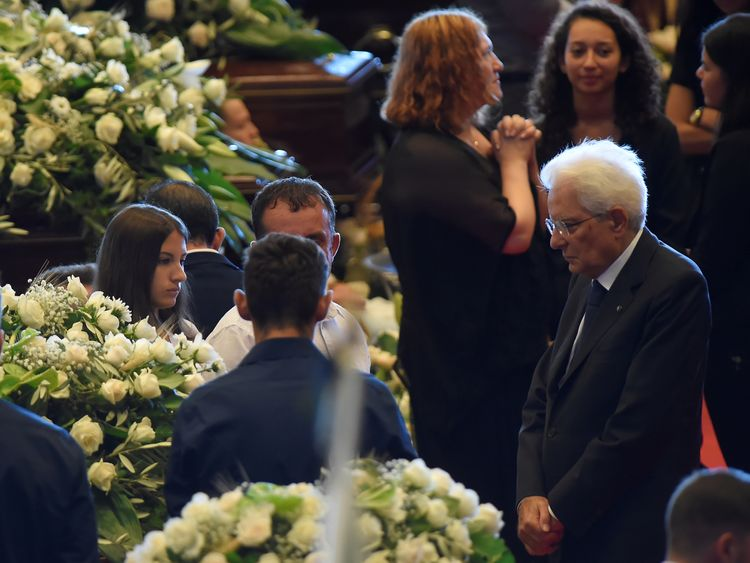 Italian president Sergio Mattarella was cheered as he entered the state funeral where he spoke to every victims' family