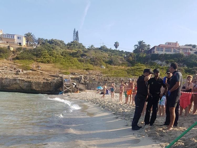 Police evacuated the beach as they tried to guide the shark back out to sea before hauling it onto the beach. Pic: Salvament Aquàtic Illes Balears