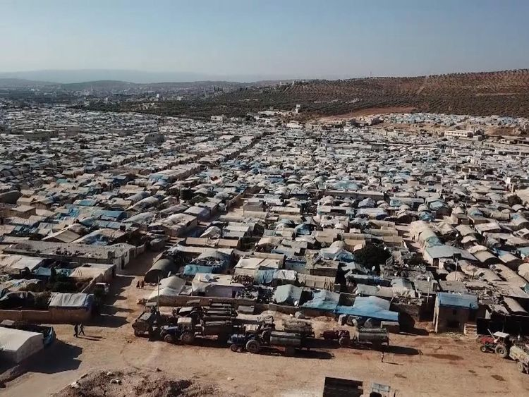 The camp for displaced people sprawls into the distance